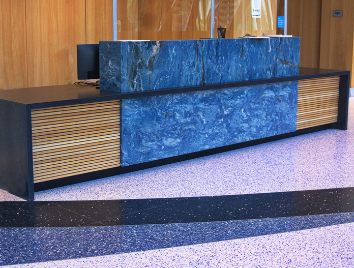 Security Desk for Schwab Corp.  Stone by Kemna Tile.